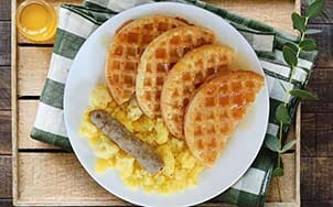 homestyle-waffles-with-scrambled-eggs-and-maple-syrup