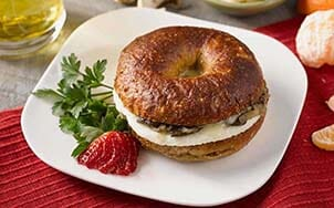 bagel-sandwich-with-caramelized-onions-mushrooms-and-swiss