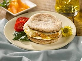 English Muffin Sandwich with Egg, Pesto, Tomato and White Cheddar